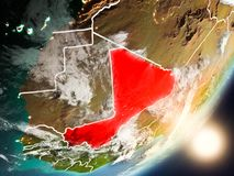 Sun rising above Mali from space. Mali from space with highly detailed surface textures and visible country borders. 3D illustration. Elements of this image Stock Images