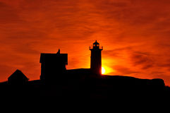 Sun rising behind the Cape Neddick Lighthouse Royalty Free Stock Photography