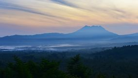 Sun rising behind the mountains in East Java Stock Images