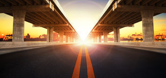 Sun rising behind perspective on bridge ram construction and asp Royalty Free Stock Photography