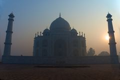 Sun rising behind Taj Mahal Stock Photo