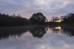 Sunrise on a  cloudy morning  at the Ornamental Pond, Southampton Common Stock Photos