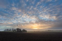 The sun is rising and the fog is clearing. In Sweden royalty free stock photo