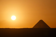 Sun rising at Great Pyramid of Giza. Landscape with sun rising at Great Pyramid of Giza Royalty Free Stock Images