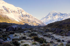 Sun is rising illuminating some part of the landscape. Landscape view inside Mt Cook National Park Stock Photos