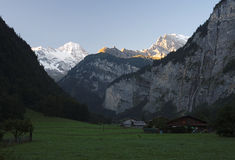 Sun is rising at the Lauterbrunnen Valley (Berner Oberland, Switzerland) Stock Images
