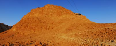 The sun is rising on Masada royalty free stock photography