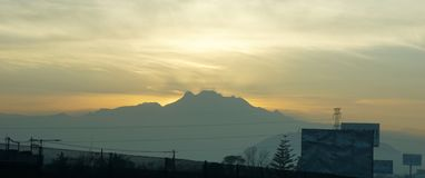 Sunrise in puebla mexico. Sun rising in the mountains of Puebla mexico, sunrise landscape over a highway in the mexico puebla way Stock Image
