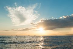 Sun rising ove Pacific ocean Stock Images