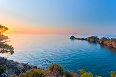 Sun rising over a calm sea in the bay Stock Photography