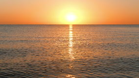 Sun Rising Over the Calm Sea. Tranquil scene, waves running towards the camera during morning sunrise on caribbean Beach, small calm waves stock footage