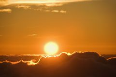Sun rising over clouds. royalty free stock photos
