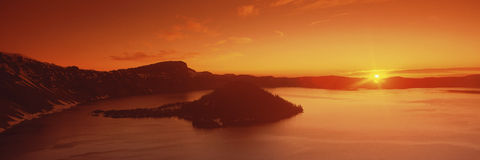 Sun rising over Crater Lake National Park Stock Photography