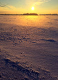 The sun rising over a frozen landscape Royalty Free Stock Image
