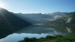 Shiny Lake under the Mountain in Summer. The sun is rising over the hill by the lake r. It`s very beautiful and quiet. It`s a good place to camping,hiking, Royalty Free Stock Images