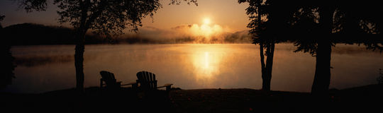 Sun rising over Lake Placid Stock Photos