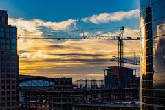 Downtown sunrise over construction site stock image