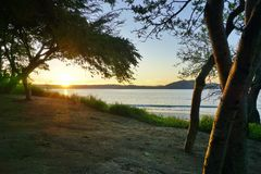 Sun rising over the Playa Blanca beach in Papagayo, Costa Rica Royalty Free Stock Images
