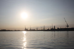 The sun rising over portsmouth harbour naval dockyard Stock Image