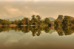 Sun rising reflection in a rainy day at Pokhara lake Nepal Stock Photography