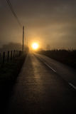 Sun rising scotland. Sun rising over a country roand in scotland Royalty Free Stock Images