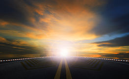 Sun rising sky and asphalt highway use as traveling and journey background stock images
