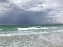 Storm clouds rising at Mirimar Beach FL. Sun rising with storm clouds looming at Florida beach Royalty Free Stock Image