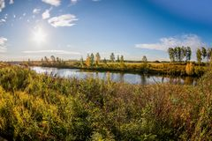 Sun is rising, walley with grass, bushes and river. Russian Autumn Royalty Free Stock Photos