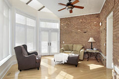 Sun room with brick wall. Sun room with windows and brick wall Royalty Free Stock Photo