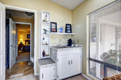 Sun room corner with cabinets and shelves Stock Images