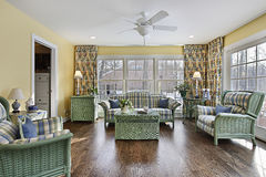 Sun room with green wicker furniture stock photos
