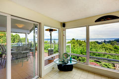 Sun room interior with door to walkout deck Royalty Free Stock Photography