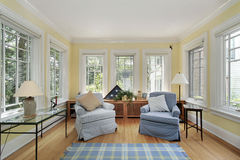 Sun room in suburban home. With wall of windows stock photography