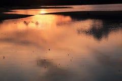 The Sun s'est reflété dans l'eau Photographie stock libre de droits