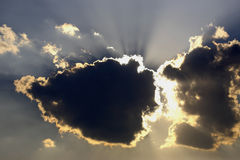 The sun's rays descend. From the clouds Royalty Free Stock Photos