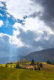 The sun`s rays illuminate the mountain valley after the rain. Stock Images