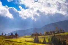 The sun`s rays illuminate the mountain valley after the rain. Stock Photography
