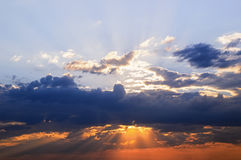 The sun's rays make their way through the clouds, the sky Royalty Free Stock Image