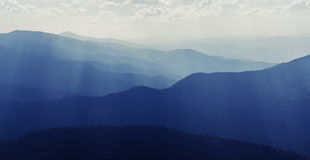 The sun's rays in the mountains at noon. Eastern Carpathians Stock Photos