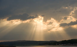 Sun's rays over Black Isle and Beauly Firth. Stock Photo