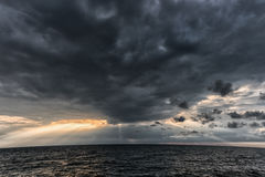 The sun's rays passing through the storm clouds over the sea. Close to Latvia, Liepaja Stock Photography
