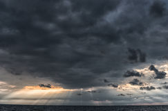 The sun`s rays passing through the storm clouds over the sea. Close to Latvia, Liepaja Stock Photography