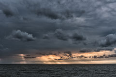 The sun`s rays passing through the storm clouds over the sea. Liepaja, Latvia Stock Photos