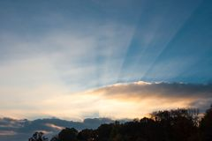 The sun`s rays pierce the clouds, the sunrise royalty free stock images
