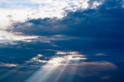 Sun`s rays. The sun`s rays shine through the dark clouds Stock Image