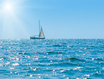Sun and sailboat Stock Photo
