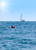 Sun and sailboat Stock Images