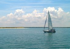 Sun and Sailboat Royalty Free Stock Image