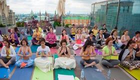 Sun Salutation (Surya Namaskara) in the centre of Moscow, Russia stock photo