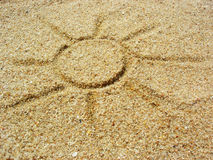 Sun on the sand. Drawing of the sun in the sand at the beach Royalty Free Stock Image